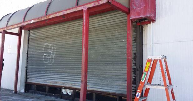 Store front gatedoor repairs baltimore gate repair baltimore store front gate in baltimore solutioingenieria Gallery